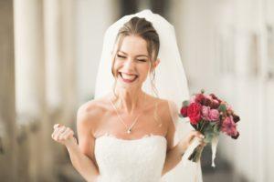 Bride smiles after getting porcelain veneers from her Oakton dentist