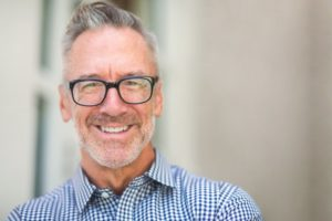 Man smiling with dental implants in Oakton